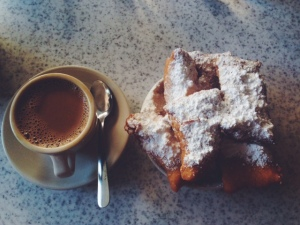 Get a cafe au lait, too, and dip your beignets. If performed correctly, you should look like you've been attacked by powdered sugar.